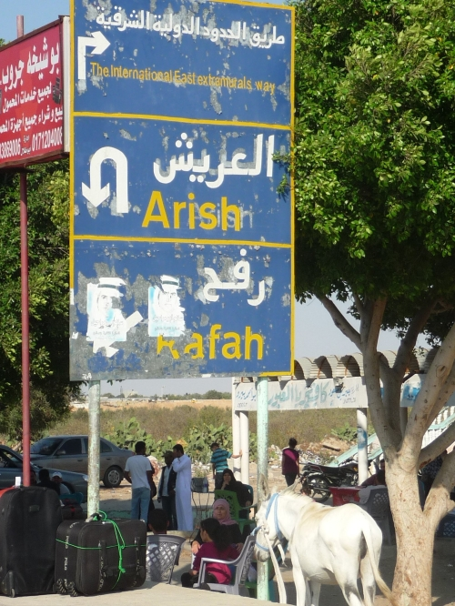 Sign at the border between Egypt and Gaza.  I took the picture in July 2011.  Now I can read and understand the Arabic!