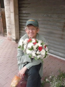 Lora with a beautiful floral arrangement in Gaza.