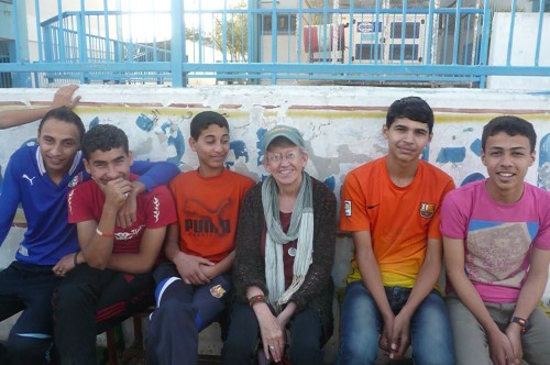 Lora with young futbol (soccer) players in Gaza.