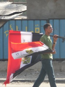 Young Egyptian selling flags near Tahrir Square.