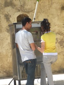 Young Egyptians at a public water dispenser in Cairo.