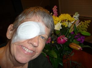 Lora with her eye bandaged after surgery.