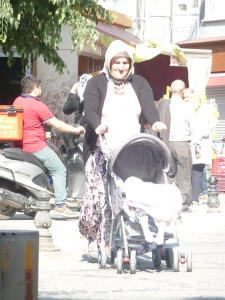 Grandmother pushing baby stroller in Istanbul.
