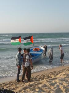 Boat with Free Gaza flags at the beach.