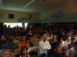 Parents and families watching performances at International Night
