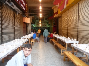 Tables spread out between buildings in downtown Cairo waiting to serve everyone after the fast is broken at sunset.