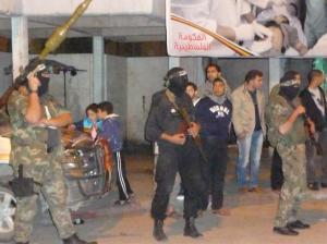 Hamas gunmen provide security for Khaled Meshaal's visit to Gaza.