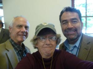 ABQ Councilor Ike Benton on left and Eric Griego (one of the symposium organizers) on the right. Whose the clown in the middle?