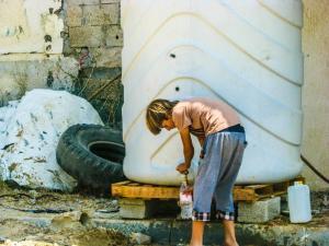 getting water in Shujaya