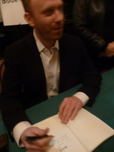 Max Blumenthal  autographing book for Refaat Alareer