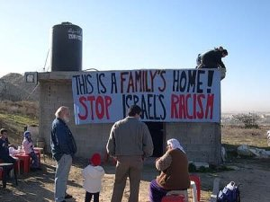 Halper standing in front of a Palestinian home threatened with demolition.