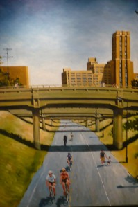 A painting of the Midtown Greenway hanging in the old Sears building.