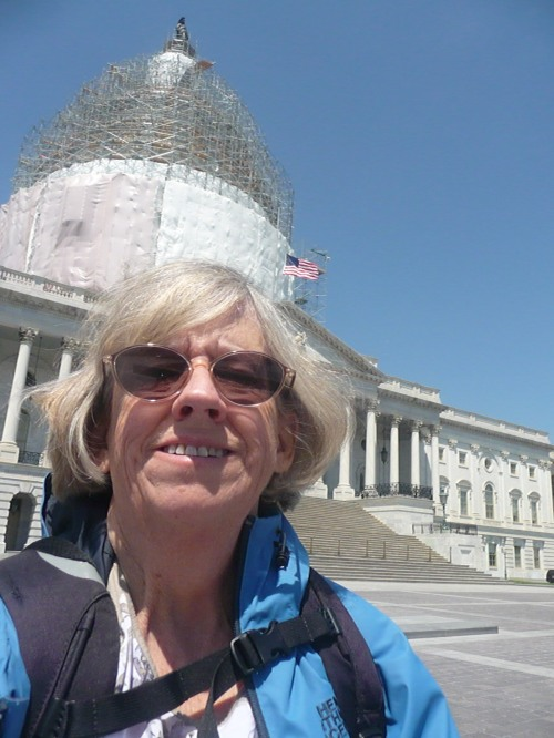 Lora squinting in front of the US Capitol
