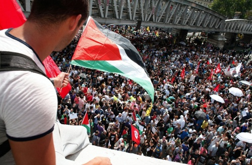 Pro-Palestinian demonstrators gather to protest against the Israeli army's bombings in the Gaza strip, in Paris, Saturday, July 19, 2014. Police have clashed with thousands of pro-Palestinian protesters who defied a ban in Paris on marching to protest the Israeli offensive in Gaza. (AP Photo/Thibault Camus)