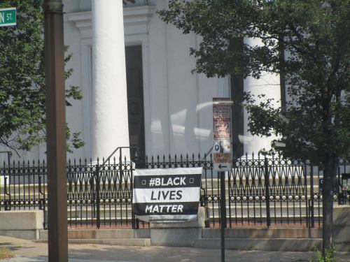 Sign on church fence in Baltimore