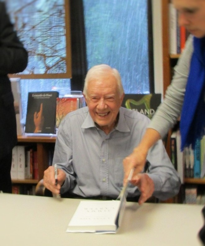 President Jimmy Carter autographing his new book, A Full Life.